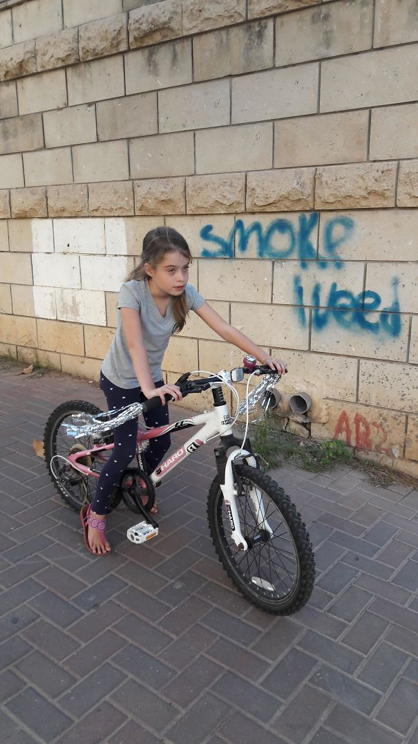 Took A Pic Of My Kid On Her New Pimped Up Bike... Didn't Pay Attention To The Graffiti In The Background