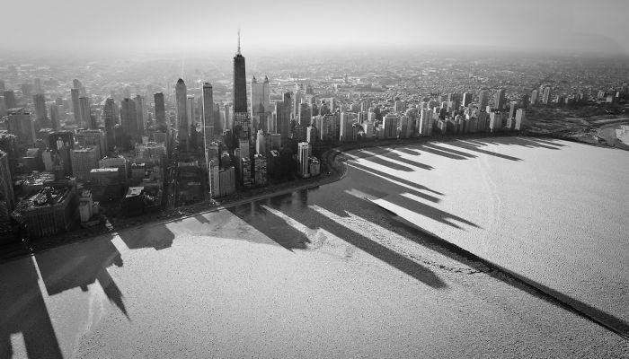 Shadows Of Chicago Over Frozen Lake Michigan, USA