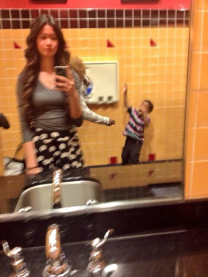 That Awkward Moment When You're Trying To Take A Selfie And A Mother Decides To Beat Her Child With Her Sandal