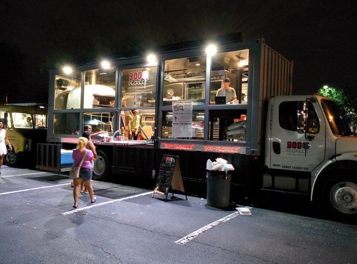 Next Level Food Truck: Pizza Parlor Inside A 35 Foot Storage Truck Containing A 3500 Pound Italian Wood-Fired Oven That Cooks Pizza In 90 Seconds. A Stairwell Leads To The Recessed Point Of Sale Area