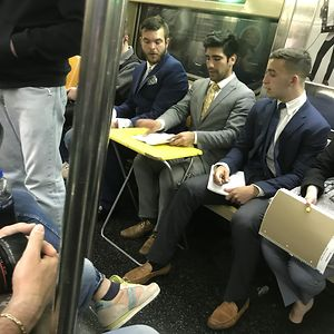 Dude Just Whipped Out This Desk On The Subway And Started His Meeting