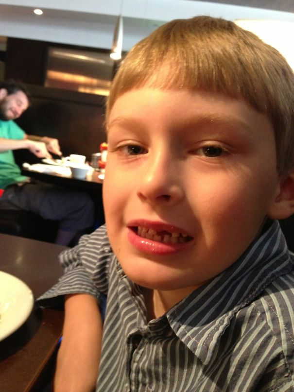 Took This Picture Of My Kid While At A Restaurant, I Can't Stop Laughing At The Guy In The Back