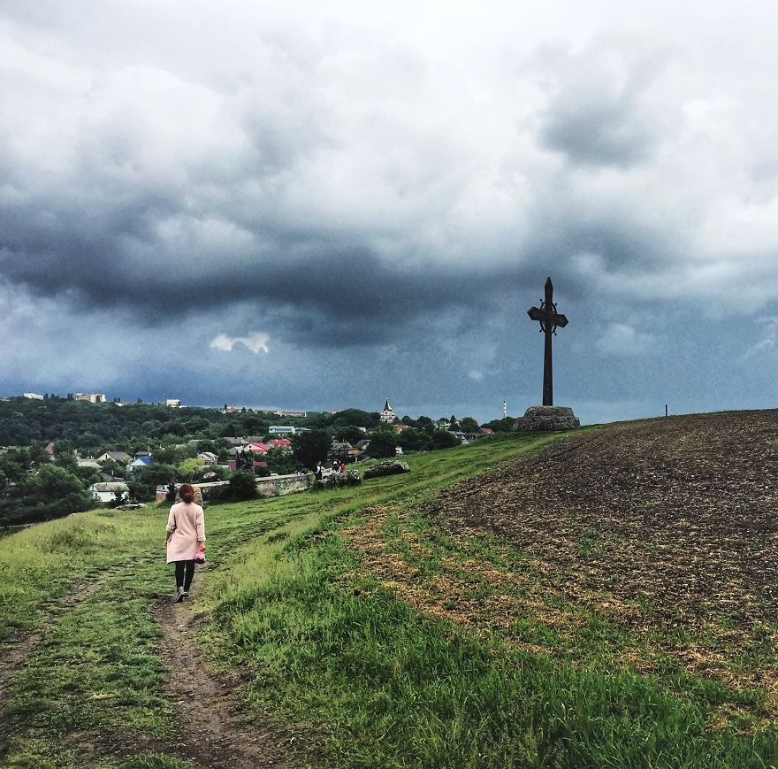 In The Shot: An Epic Journey To The Huge Cross On The Edge Of The Mountain. Behind The Scene: Getting Wet From The Rain And Being Afraid Of The Cows On My Left, Cows On My Right And Cows Behind The Photographer. (That's Ukraine, Btw)