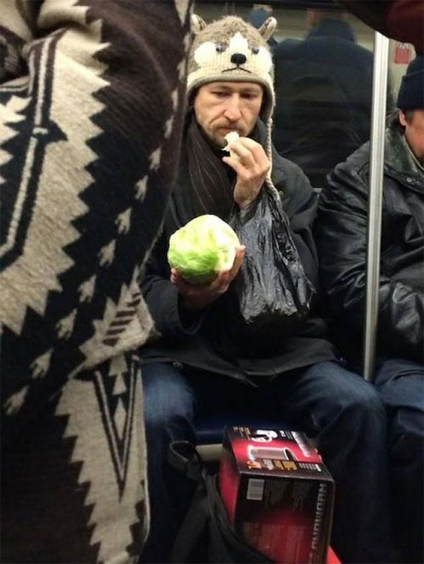 Subway Rider Eating A Head Of Lettuce