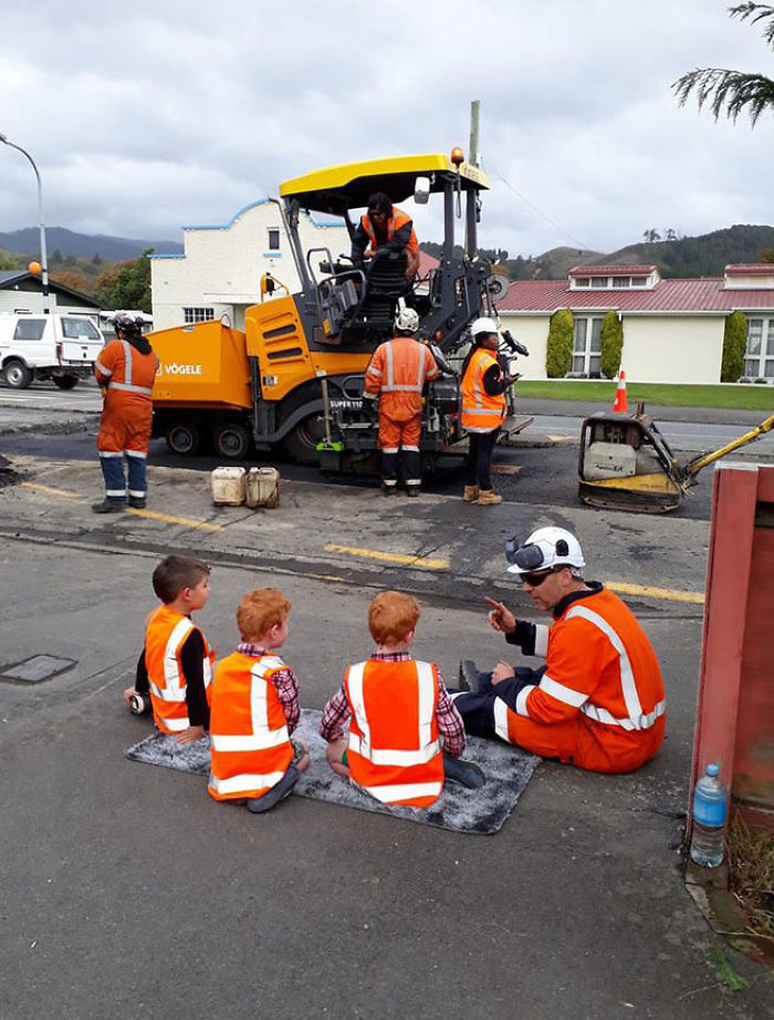 These Workmen Are Awesome. This Man Has Sat Down For A Few Minutes To Explain To Our Boys All About The Road Works