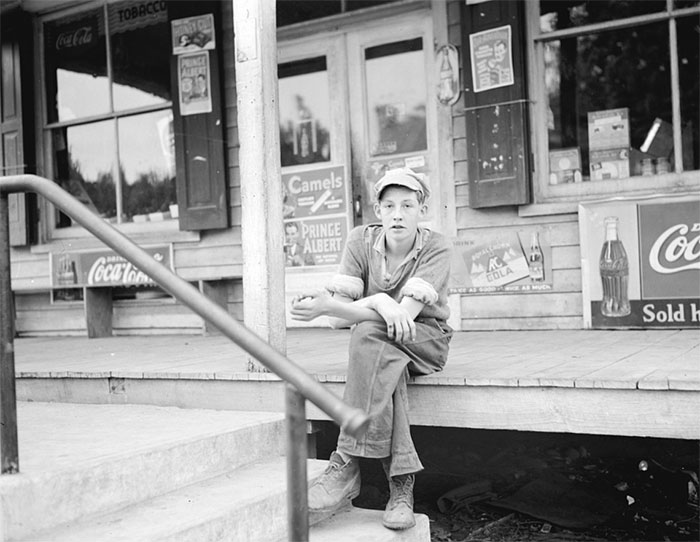 Boy On Porch Of General Store, Roseland, Virginia, 1938