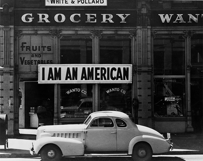 "A Large Sign Reading ""I Am An American"" Placed In The Window Of A Store, On December 8, The Day After Pearl Harbor. The Business Was Owned By The Matsuda Family. The Store Was Closed Following Orders To Persons Of Japanese Descent To Evacuate From Certain West Coast Areas"
