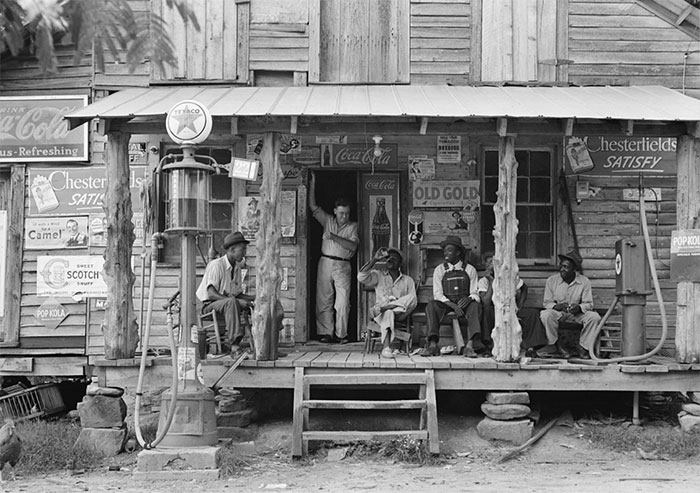 Country Store On Dirt Road. Note The Kerosene Pump On The Right And The Gasoline Pump On The Left. Brother Of Store Owner Stands In Doorway. Gordonton, North Carolina, 1939