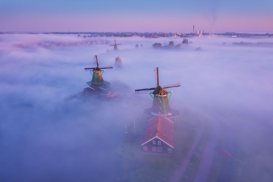 Thick Fog Covering The Ground With The Windmills Sticking Out. An Unreal Sight