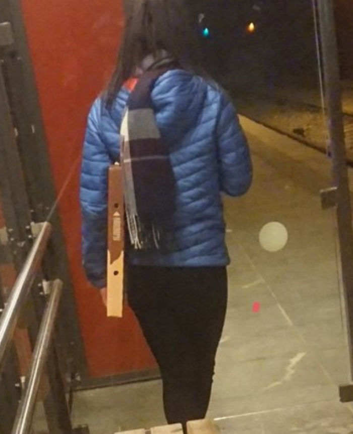 People Carrying Their Pizza Like This