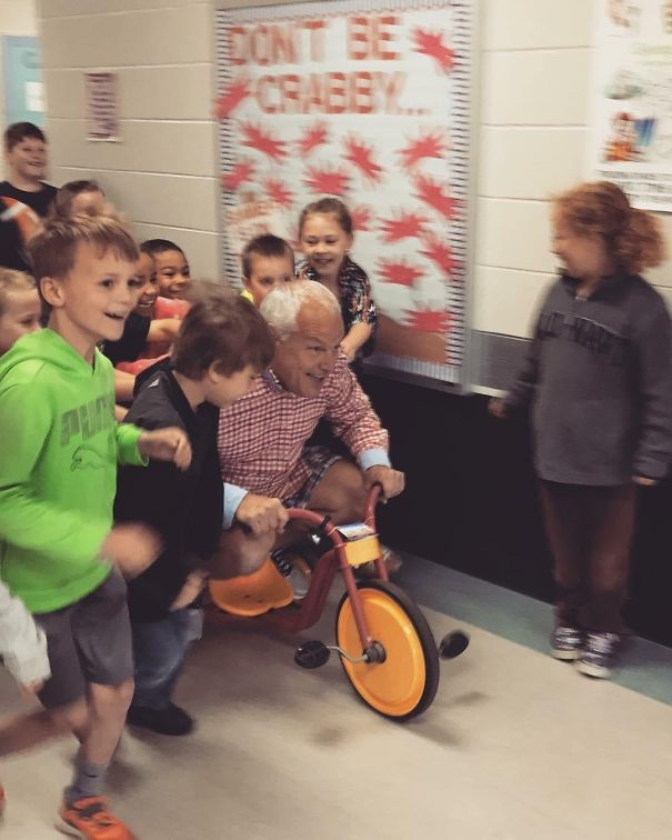 My Dad Challenged The Students At The School Where He Is The Principal To Read A Combined 1,000 Minutes. The Reward Would Be Getting To Push Him Down The Hall On A Tricycle While He Wore Mismatched Clothes Inside Out