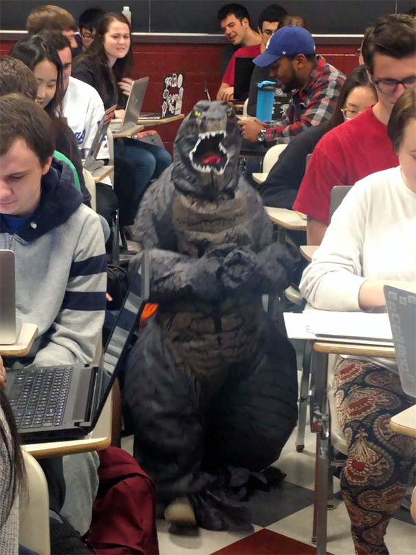 My Cousin's Son Is On Spring Break, So Today She Brought Him To Help Teach Her Class. He Decided To Wear His Godzilla Outfit