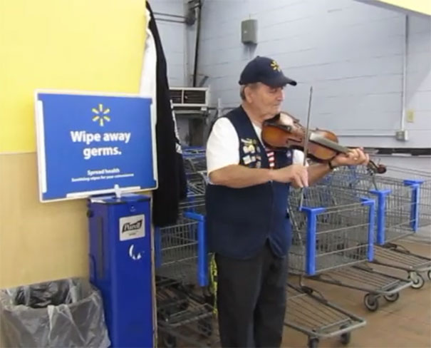 My Local Wal-Mart's Greeter Is Always Playing Guitar Or Violin. He's A Cool 'Person Of Wal-Mart'!