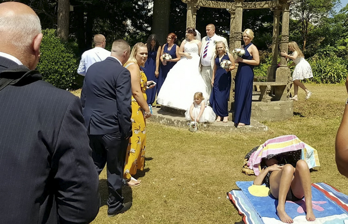 Couple Forced To Take Wedding Pics With Sunbathing Woman, And Internet Can't Decide Who's The Asshole