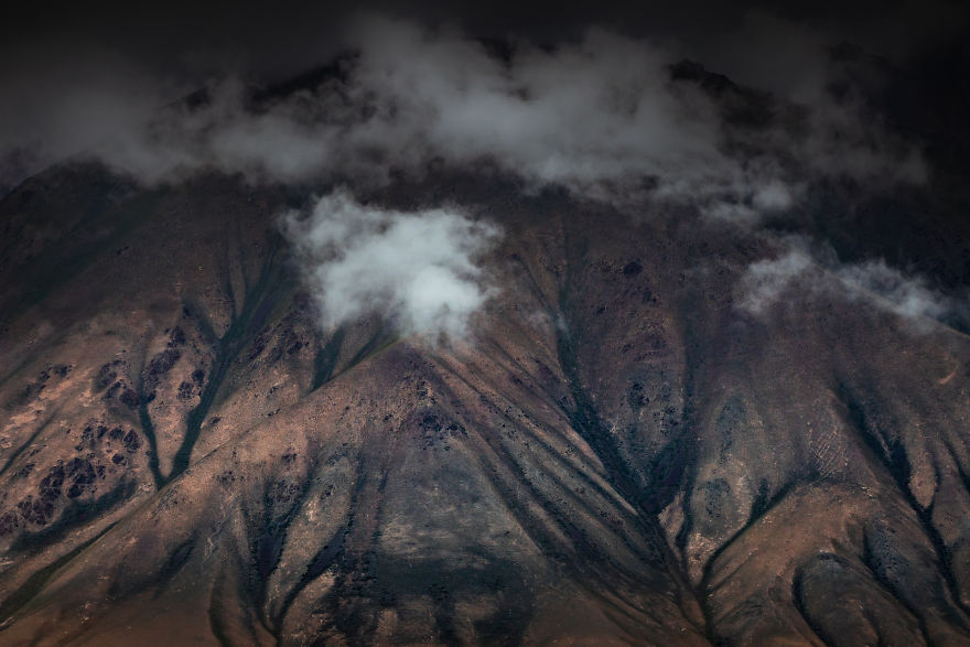 A Textured Detail Of Mountain That Looks Like It's From Another Planet
