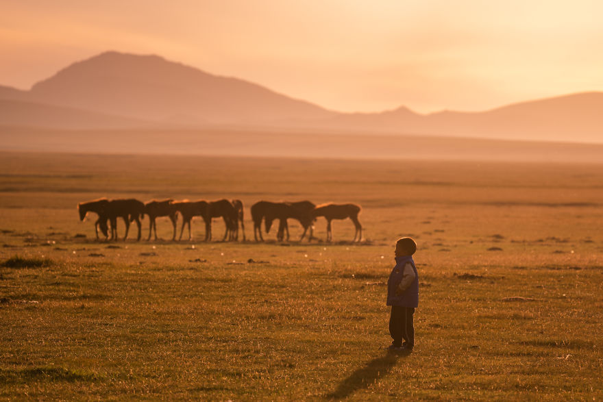 A Kid Of The Local Family Enjoying The Sunset At Song-Kul