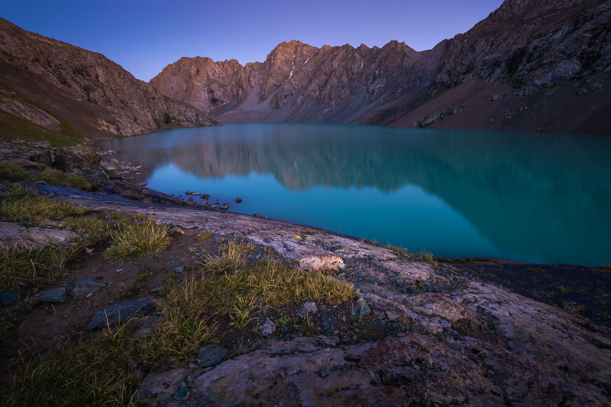 Ala-Kul Lake At An Altitude Close To 4000m Reflecting In It's Turquoise Waters