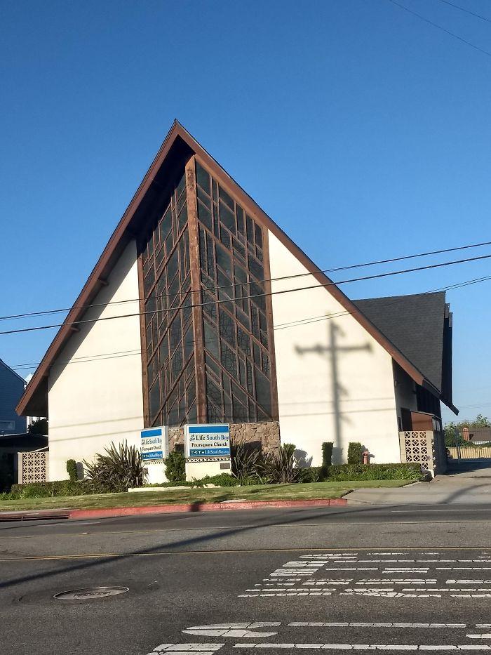 The Telephone Pole's Shadow Makes A Cross On The Church Across The Street