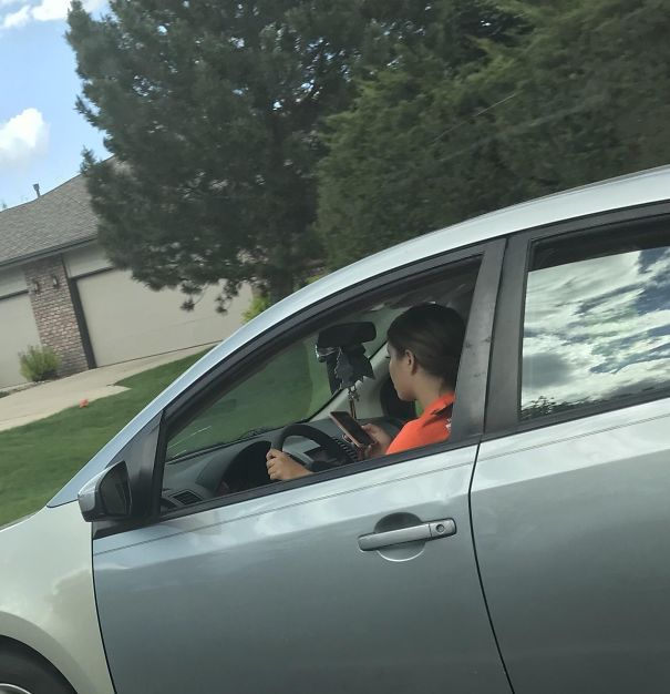 She Was Snapchatting While Driving (40 MPH Road (64,4 KPH)). She Also Had A Little Brother In The Passenger Seat While Doing This