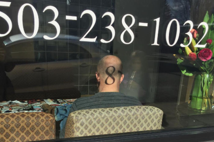 This Projection Of A Telephone Digit Onto The Back Of A Man's Head