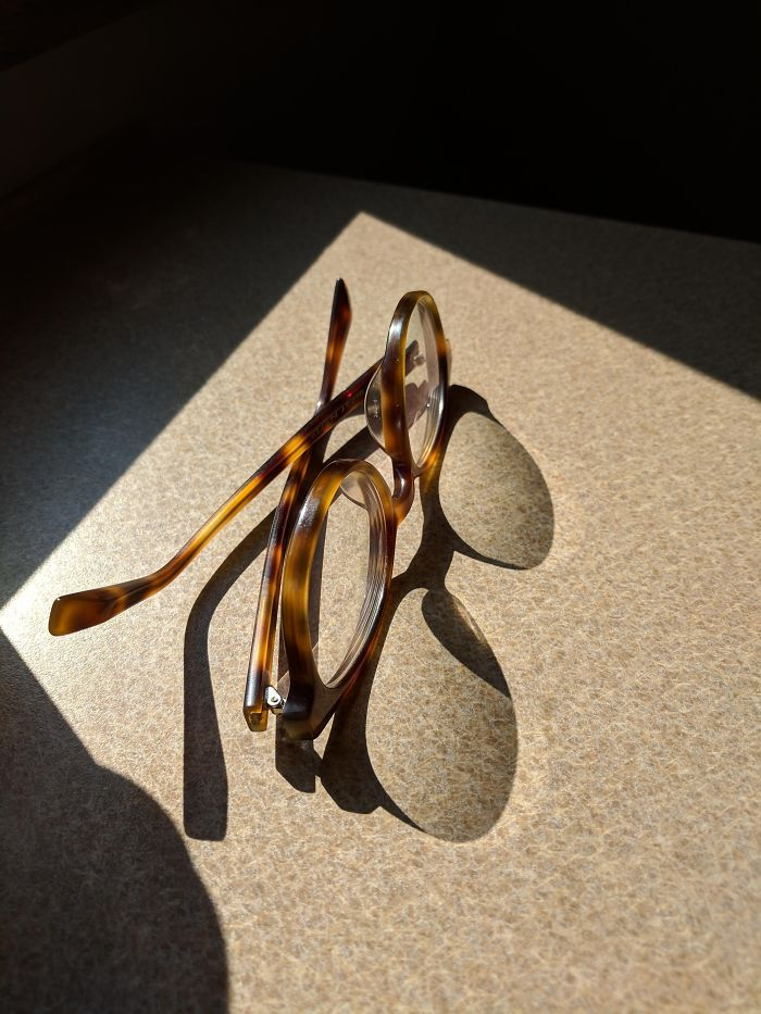 The Shadow Of These Eyeglasses Looks Like A Different Style Of Eyeglasses