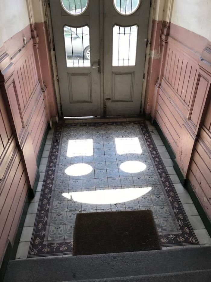 Windows On The Entrance Of My Apartment Creating A Smiley Face In Sunlight