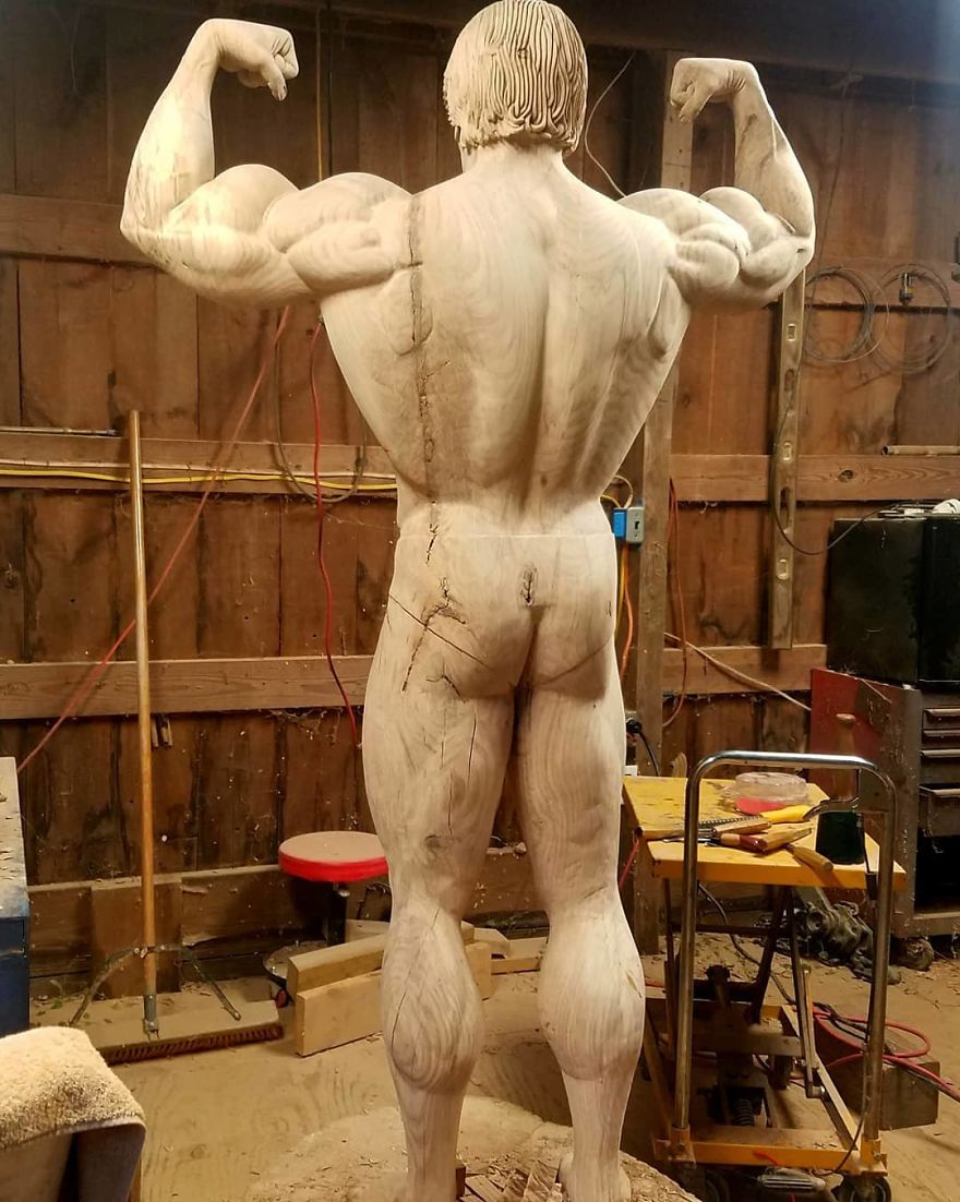 Sculptor Creates A Life-Size Statue Of Arnold Schwarzenegger Out Of Tree Trunk