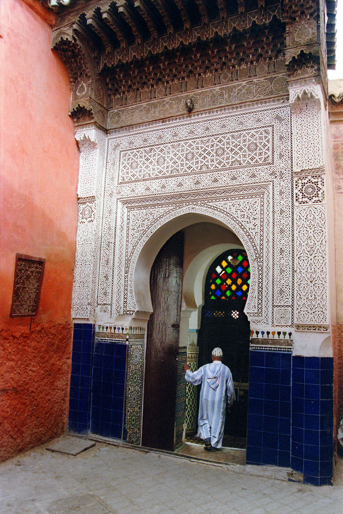 The Marrakech Medina Is Full Of Architectural Wonders. A Man Enters The Mausoleum Of Sidi Abdel Aziz