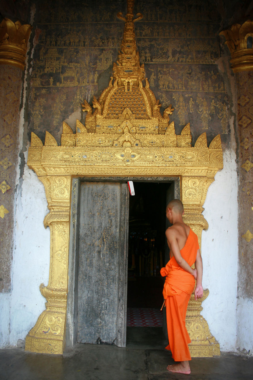 A Monk Invites Me To Visit The Monastery Of Wat Xieng Thong In Luang Prabang