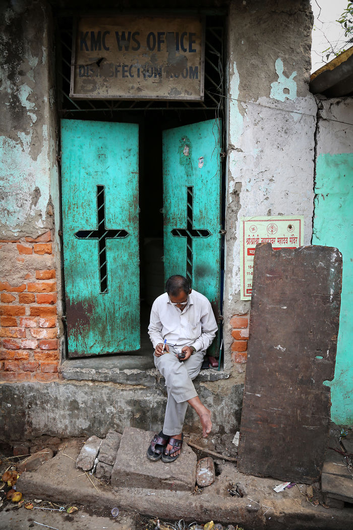 A Man Checks His Mobile Phone In A Street Near Howrah Station In Kolkata, India