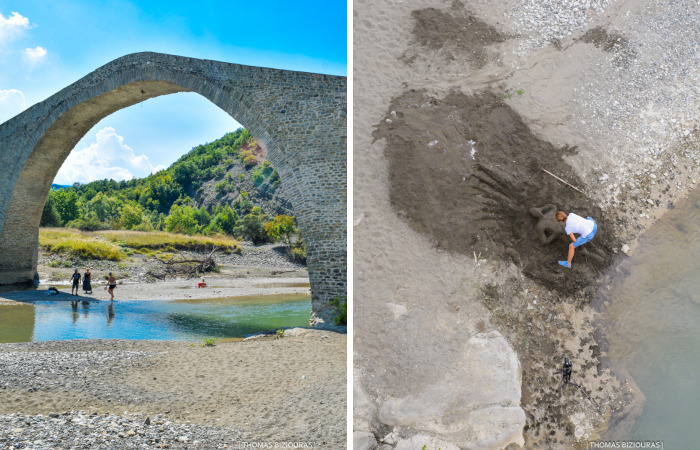 Dimitra Created An Amazing Sand Sculpture In Front Of An Old Stone Bridge