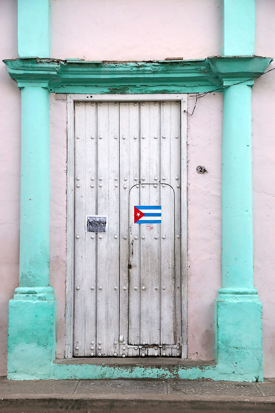 The Cuban National Flag Is Displayed On The Door Of A House In The City Of Bayamo, Cuba