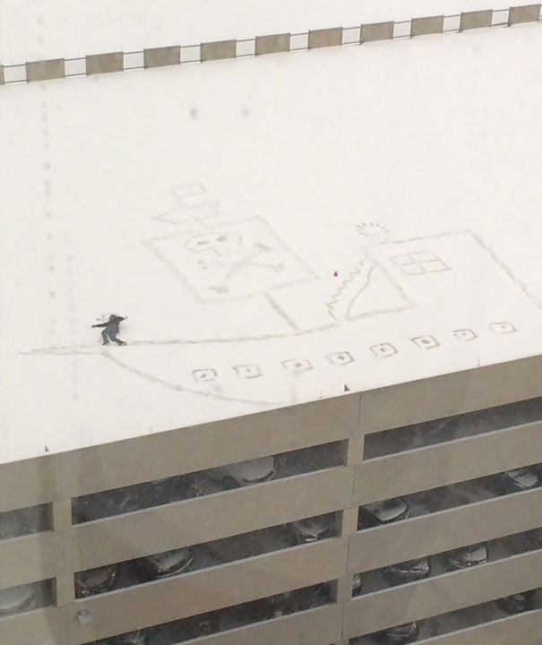 Guy Working On The 13th Floor Looked Out The Window At The Top Of The Parking Garage, And Had An Idea. This Is The Result