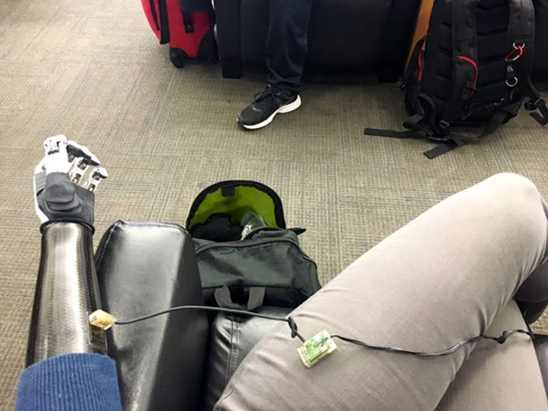 """""""Forgot To Charge Arm Last Night. Charging At Cellphone Charge Area At Airport"""" Angel Giuffria"""