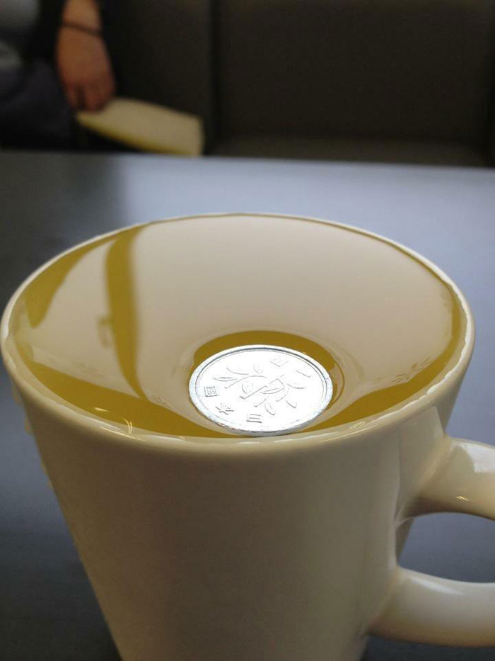 A Japanese 1 Yen Coin Is So Light It Won't Even Break Surface Tension On Water
