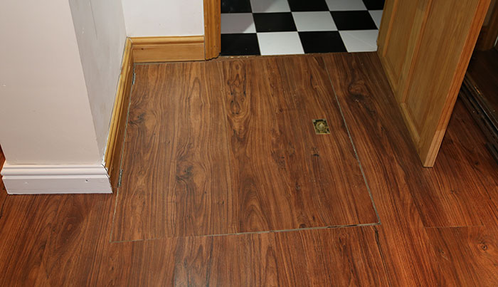 Guy Discovers A Trap Door In His Apartment Floor, Finds Something That Wasn't In The Lease