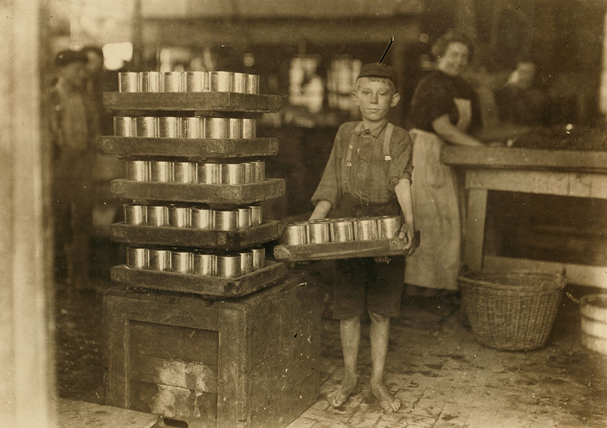 One Of The Small Boys In J. S. Farrand P[ac]king Co. And A Heavy Load. J. W. Magruder, Witness. Location: Baltimore, Maryland