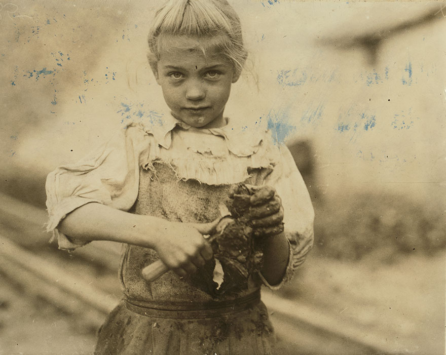 7-Year Old Rosie. Regular Oyster Shucker. Her Second Year At It. Illiterate. Works All Day. Shucks Only A Few Pots A Day. Varn & Platt Canning Co. Location: Bluffton, South Carolina