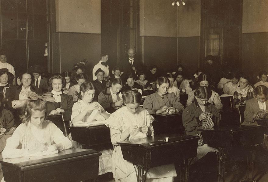 Working Girls Learning Dressmaking In The Free Evening School. Location: Boston, Massachusetts