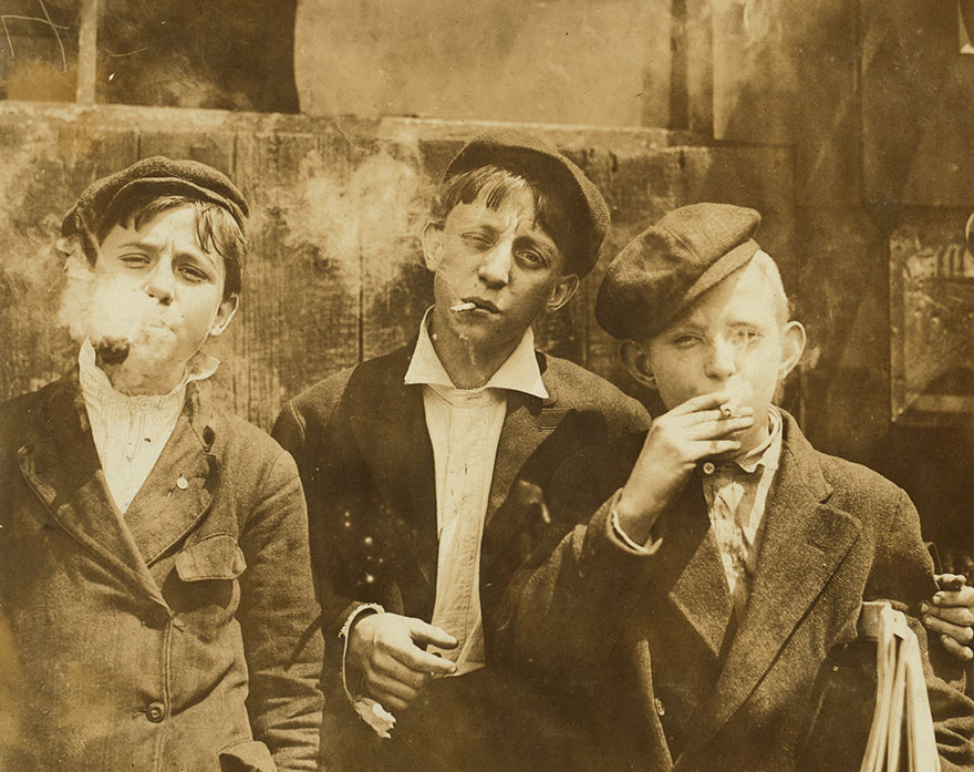 11:00 A. M . Monday, May 9th, 1910. Newsies At Skeeter's Branch, Jefferson Near Franklin. They Were All Smoking. Location: St. Louis, Missouri