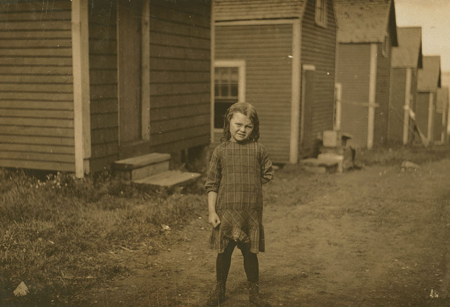 """Elsie Shaw, A 6 Year Old Cartoner During The Summer. [her Father] Asked Me To Take Some Photos Of Her, As He Has Her Do A Singing Act In Vaudeville In The Winter, """"And She's Old Enough Now To Go Through The Audience And Sell Her Own Photos."""" Location: Eastport, Maine"""