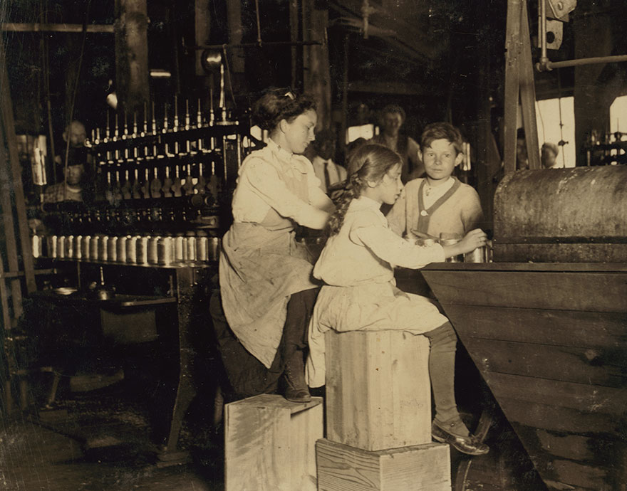 """Daisy Langford, 8 Yrs. Old Works In Ross' Canneries. She Helps At The Capping Machine, But Is Not Able To """"Keep Up."""" She Places Caps On The Cans At The Rate Of About 40 Per Minute Working Full Time. Location: Seaford, Delaware"""