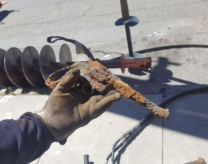 A Utility Worker Just Dug Up This Old Revolver From Under The Sidewalk