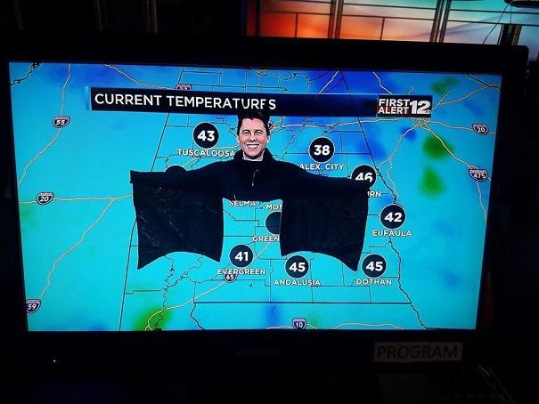 My Local Weatherman Dressed As A Bat For Halloween