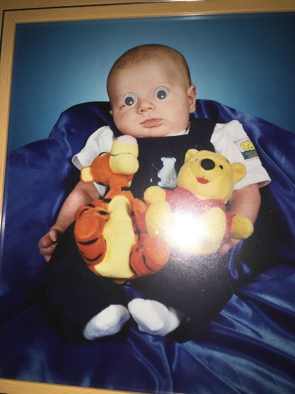 About 5 Years Ago, I Put Googly Eyes On A Picture Of My Brother As A Baby. They're Still There To This Day