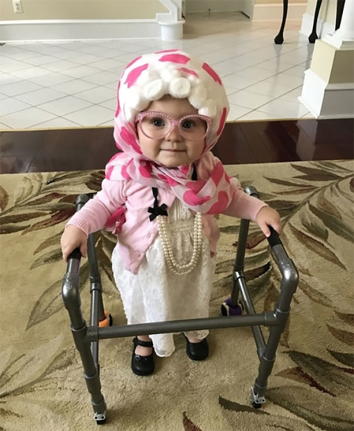 "Our Daughter, Claire, Dressed Up As Grandma Completed With A ""Granny"" Style Clothes, Homemade Wig, Pearls And A Walker Built By Daddy. Claire Walks Well Without Assistance, But Stroles Along With Her Walker"