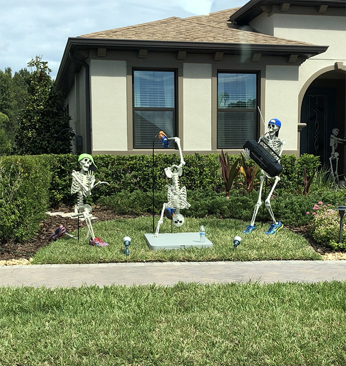 Girl Notices Her Neighbor S Halloween Skeletons Are Playing