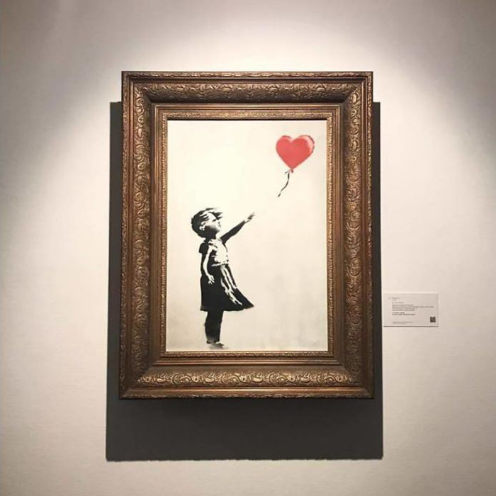 Banksy Artwork Shredded Itself Seconds After Being Sold For More Than 1 Million Dollars