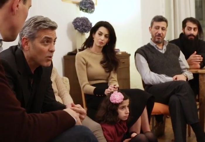 In March 2016, He And His Wife, Amal Clooney, Met With Syrian Refugees Living In Berlin To Mark The Fifth Anniversary Of The Conflict, Before Meeting With German Chancellor Angela Merkel To Thank Her For Her Germany's Open-Door Policy
