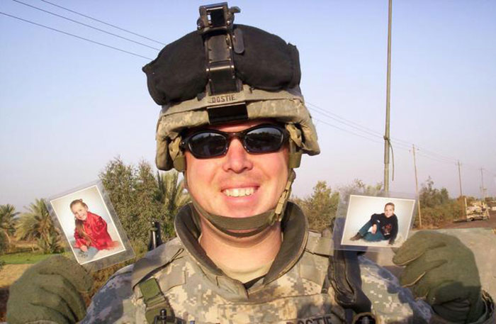 My Father, SFC Shawn Dostie, Holding Up Pictures Of My Sister And I
